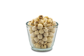 Fototapete - Dried Lotus seeds in a glass bowl on white background with clipping path. Nowadays lotus seed become popular healthy food and has highly beneficial for health.