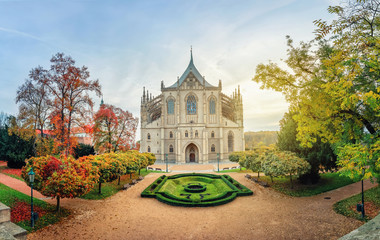 Kutna Hora, Czechia. Wide angle view of St Barbara's Cathedral on sunrise with autumn trees (HDR-image)