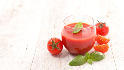 Wall Mural - tomato sauce or tomato gazpacho with basil