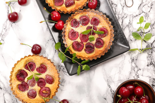 clafoutis with cherry cake- french tart with cherry and cream