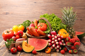 Foto auf AluDibond London assorted of fruit and vegetable on wood background