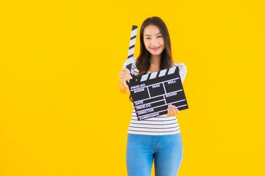Portrait beautiful young asian woman show clapper movie board
