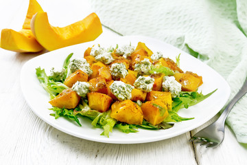 Wall Mural - Salad of pumpkin and cheese in plate on board