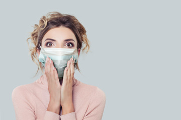 Shocked woman in protective face mask
