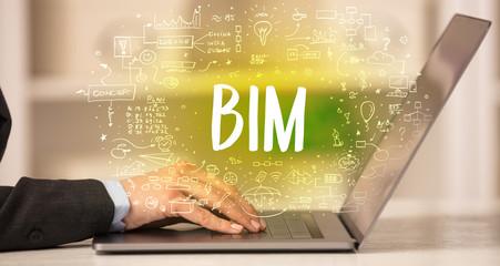 hand working on new modern computer with BIM abbreviation, modern technology concept