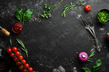 Food background. Vegetables, spices and kitchen utensils on the old table. Free copy space.