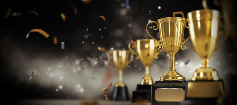 Golden trophy award on dark background.  Gold winners trophy with copy space for text.  3d rendering.