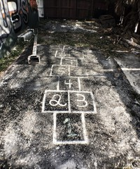 High Angle View Of Hopscotch Grids At Playground