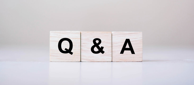 Q&A word with wooden cube block. FAQ( frequency asked questions), Answer, Question & Ask, Information, Communication and Brainstorming Concepts