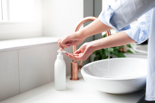 Woman washing and lathering hands. Liquid antibacterial soap and foam. Infection prevention. Self care and hygiene. Close up. Avoid spreading viruses and germs. Step by step instructions. Step 1.