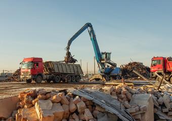 loading scrap metal and debris onto a truck