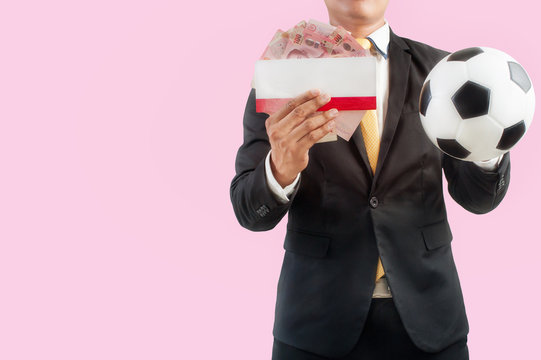 Businessman holding football or ticket and money on pink abstract background