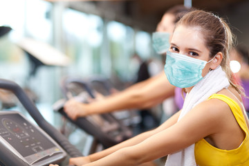 People doing fitness wearing a mask - coronavirus concept