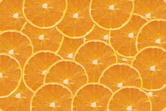 Freshly cut oranges as background