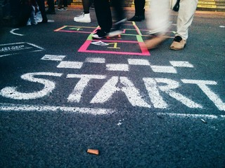 Fotomurales - Low Section Of People Playing Hopscotch