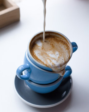 Close-up Of Pouring Coffee In Cup