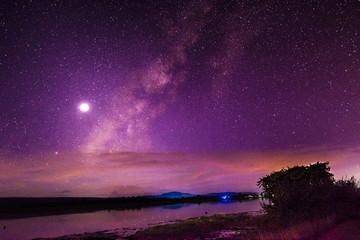 Foto auf AluDibond Violett Scenic View Of Sea Against Star Field At Night