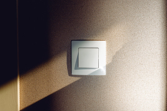 Electric light switch on the wall