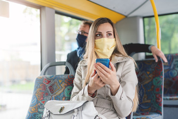 People wearing masks in the bus using public transport