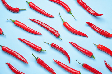 Photo sur cadre textile Hot chili Peppers Hot chili pepper on color background