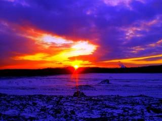 Foto auf Gartenposter Violett Snow Covered Landscape At Sunset