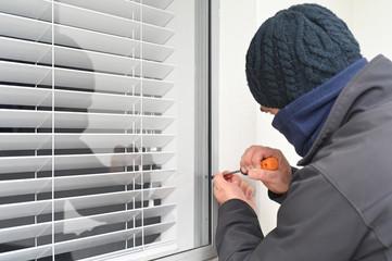 Burglar breaking into - fototapety na wymiar