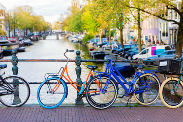colorful bicycle on a canal bridge in Amsterdam