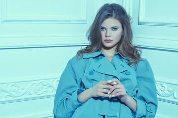 model in blue coat