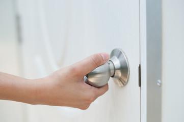 Fototapeta Close-up Of Hand Opening Door obraz