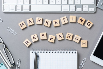 Marketing research concept with letters on cubes