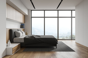 White and wooden master bedroom with window