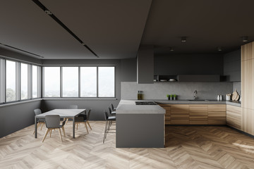 Gray and wood kitchen interior with bar and table