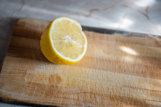 High Angle View Of Lemon Slice On Cutting Board