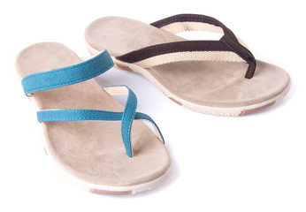 Close-up Of Flip-flop Against White Background Wall mural