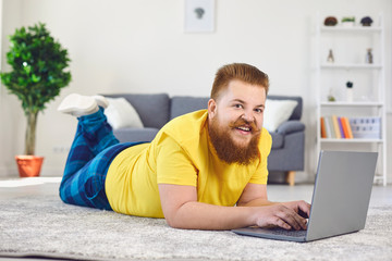 Online work job training . Funny man with a beard working in a laptop at home