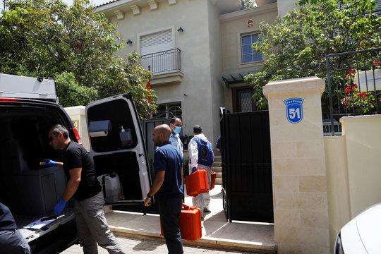 Israeli police forensic experts carry equipment into the house of China's ambassador to Israel, Du Wei, in Herzliya, near Tel Aviv, Israel