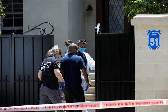 Israeli police and forensic experts enter the house of China's ambassador to Israel, Du Wei, in Herzliya, near Tel Aviv, Israel