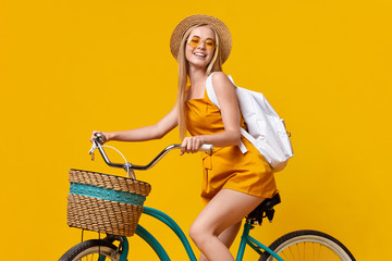 Summer Style. Teen Girl Wearing Hat, Sunglasses And Backpack Riding Vintage Bicycle