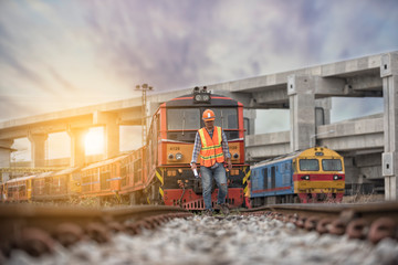 worker on railways with  locomotive  on background.