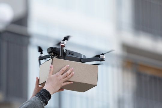 New drone with package box, delivery service modern electronic device