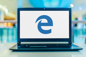 Laptop computer displaying logo of Microsoft Edge