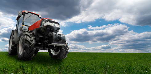 Red tractor on a agricultural field