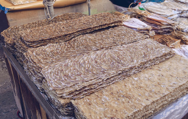 thin pieces of dried fish for sale at korean market