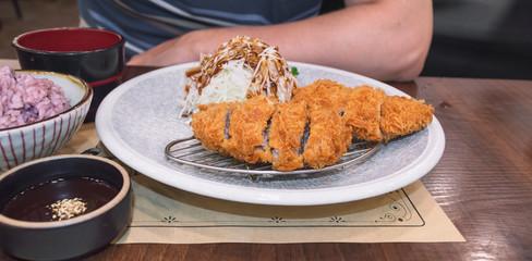 Tonkatsu close up with cabbage salad and rice