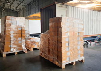 Interior of warehouse dock, Large pallet shipment goods, Truck docking load cargo at warehouse, Road freight delivery logistics shipping and transport