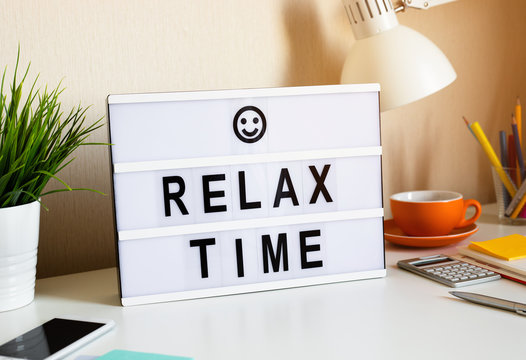 Relax time and work balance concepts with text on light box on desk table in home office.positive emotion to success
