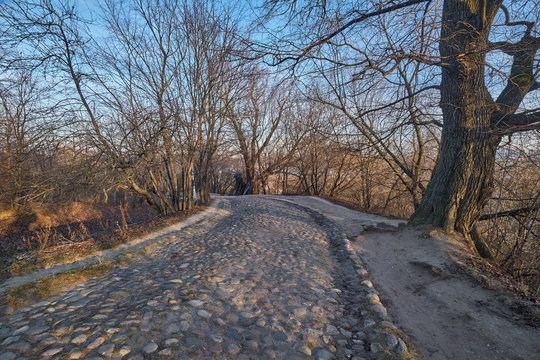 Old cobblestone road in a hilly park. Moscow, Kolomenskoye park