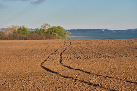 Landscape with plowed spring fields
