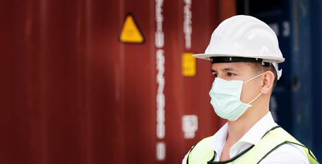 Construction workers wear safety helmet And the mask in the factory Or container. Prevent accidents...