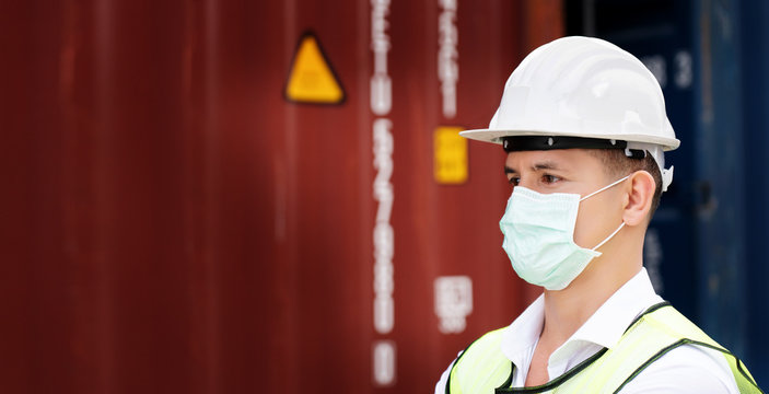 Construction workers wear safety helmet And the mask in the factory Or container. Prevent accidents at work or dust, secretion that spread Coronavirus. Social distancing. Concept New Normal